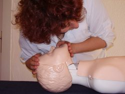 CPR on a dummy at a first aid course